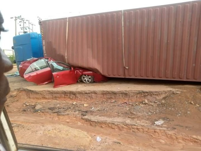 Occupants escape unhurt as container falls on vehicle