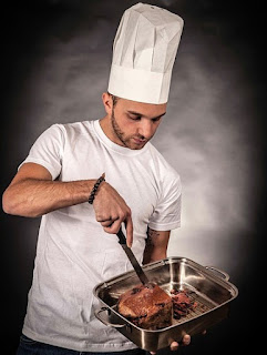 Thin Man with Chef Hat Cooking a Roast