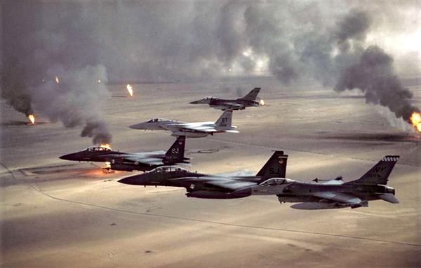 U.S. warplanes fly over burning oil wells in Kuwait during Operation Desert Storm...in February of 1991.