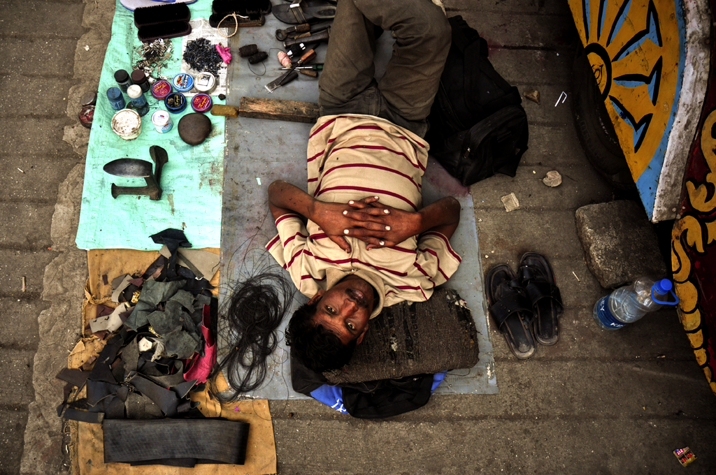 Shoe polisher in India submitted to the 'Portrait Awards 2021' photo competition on LensCulture.