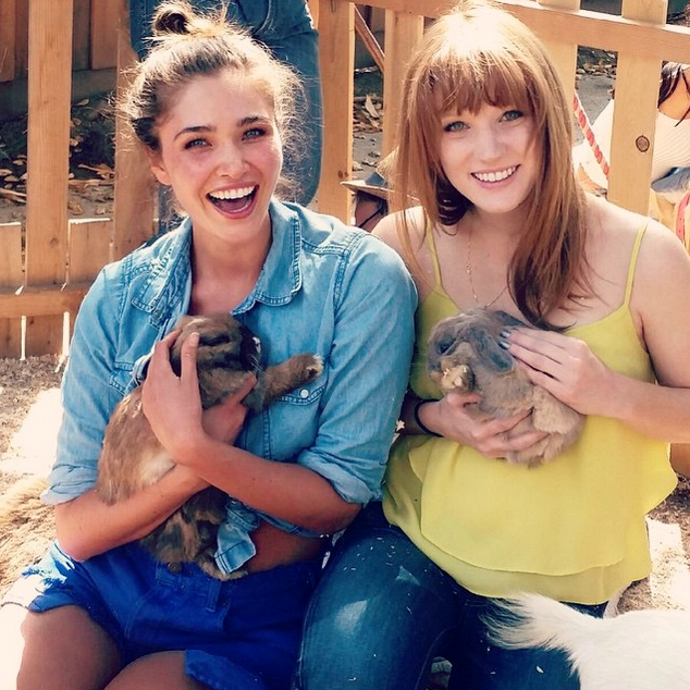 Chanel Celaya and Brooke Christy holding rabbits in arms
