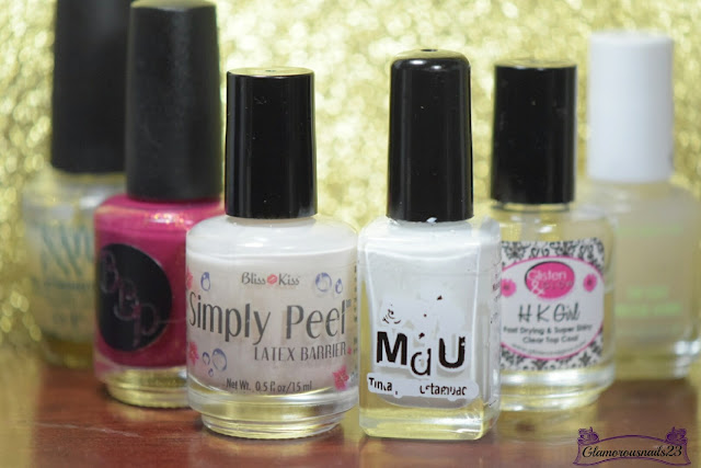 O.P.I Original Nail Envy, Bad Bitch Polish Drunk Aunt Alice, Bliss Kiss Simply Peel Latex Barrier, Mundo De Unas White, Glisten & Glow HK Girl Fast Drying Top Coat, Essie Matte About You