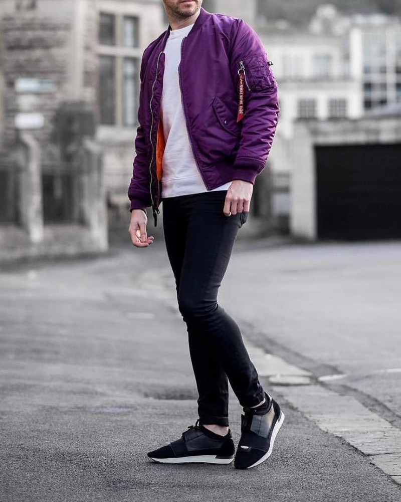 Man wearing Bomber jacket over crew neck t-shirt and joggers.