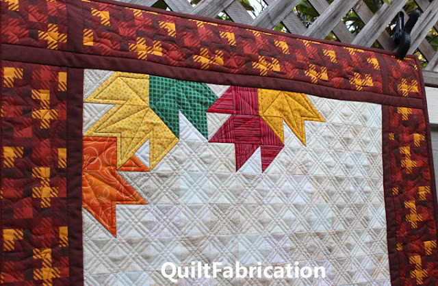 orange yellow green and red maple leaves at the top of Pumpkin Peek-a-Boo wall hanging by QuiltFabrication