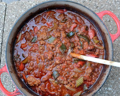 Crockpot Chili with Spicy Sausage ♥ KitchenParade.com, just cook ground beef and spicy sausage, then dump it all into a slow cooker or Dutch oven for slow cooking in the oven or on the stove. Meaty and man-friendly!