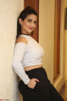 Manjusha in sleevelss crop top and black skirt at Darshakudu pre release ~  Exclusive Celebrities Galleries 038.JPG