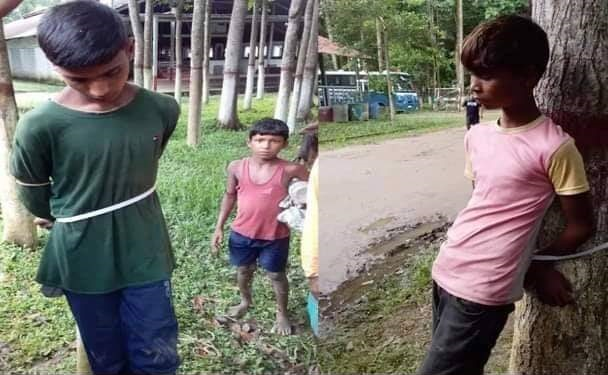 Two children tortured tied with tree