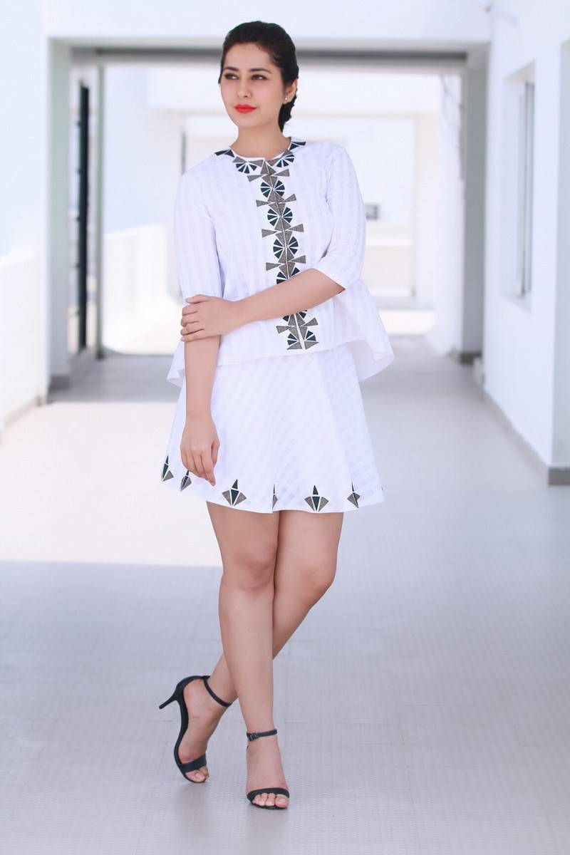 Rashi Khanna Cross Legs Show Stills In White Mini Skirt
