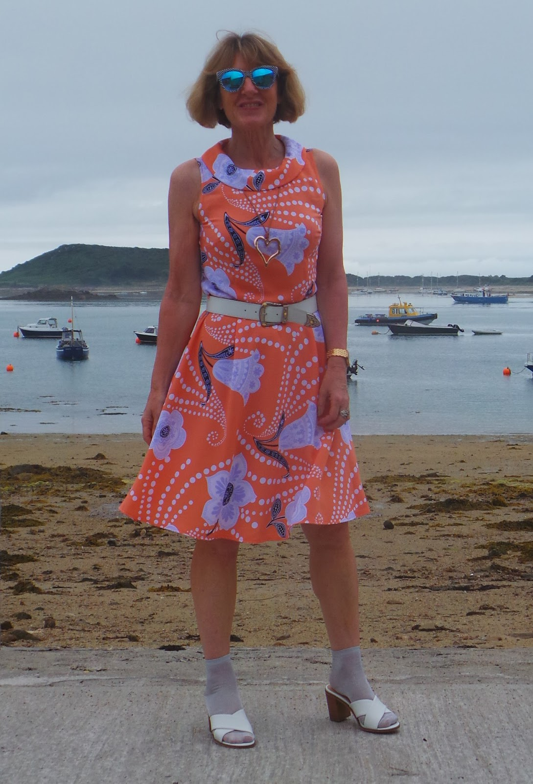 Anna Parkes from Annas Island Style in retro orange and mauve frock with ankle socks and sandals