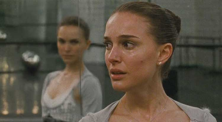 Natalie Portman struggles as Nina Sayers in Black Swan.