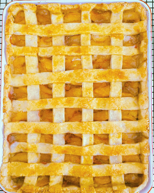 Fresh Vanilla Peach Slab Pie,  fresh juicy peaches in a buttery lattice crust, baked in a rimmed baking sheet pan.  Easy to serve and perfect for a large crowd.