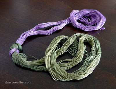 Lavender and Green over-dyed variegated threads for use on a lavender pincushion
