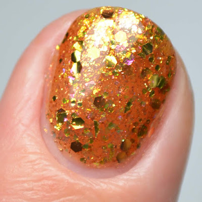 gold glitter nail polish swatch close up