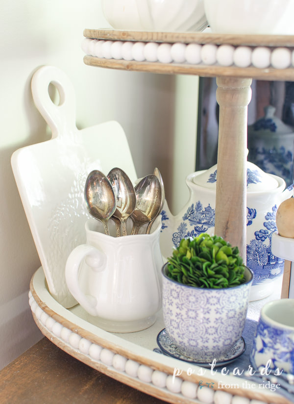 tiered tray with blue, white, and green vintage decor