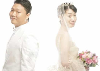 Yoo Hye-yeon with her husband PSY in their wedding dress