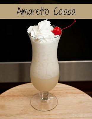 Amaretto Colada is the perfect blended cocktail using rum, amaretto and pineapple juice.