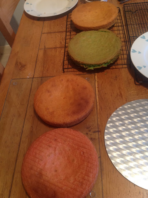 various coloured sponge cake layers for rainbow cake