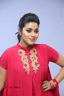Actress Poorna Latest Stills in Red Dress at Rakshasi First Look Launch  0171.JPG
