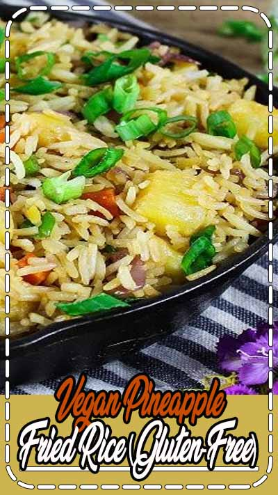 Are you looking to order some take-out tonight? Well, put that phone down because this homemade Pineapple Fried Rice is much healthier, tastier & uber-easy to make. #pineapplefriedrice #veganfood #plantbased #friedrice #veganhuggs
