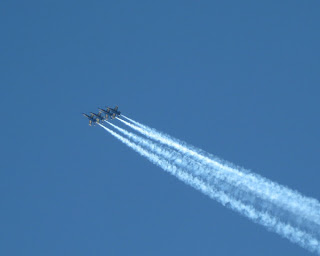 Four Blue Angels streak across the sky, San Francisco, California
