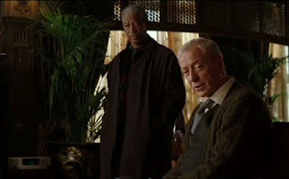 Morgan Freeman as Lucius Fox and Michael Caine as Alfred Pennyworth in Batman Begins