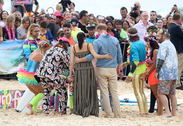 Meghan Markle wore Martin Grant Pleated Stripe Long Dress. The Duke and Duchess of Sussex visited Bondi Beach