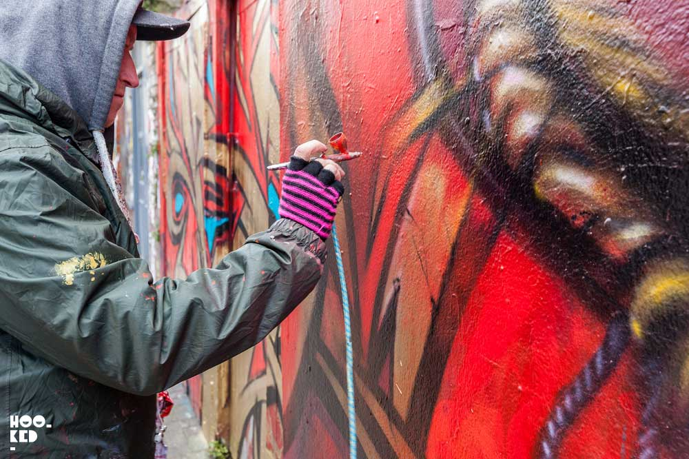 English Street Artist Dale Grimshaw at work on his London Mural