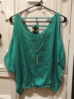 cold shoulder teal dress shirt with gold tassel necklace
