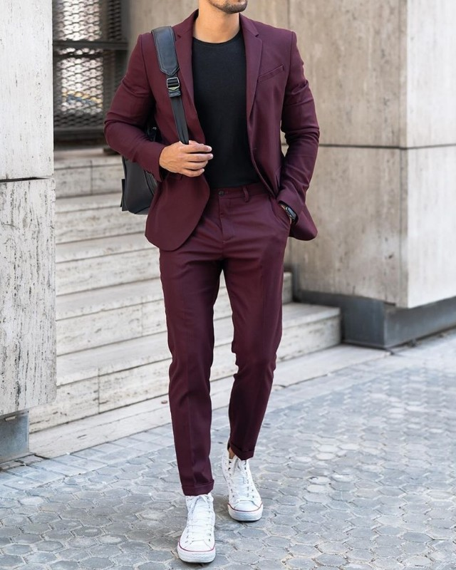 Men in wine color suit and black t-shirt.