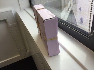 Mystery box sat on a windowsill