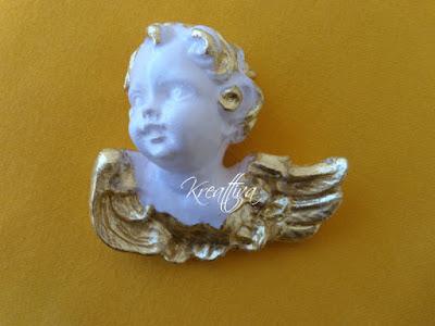 angioletto con foglia d'oro