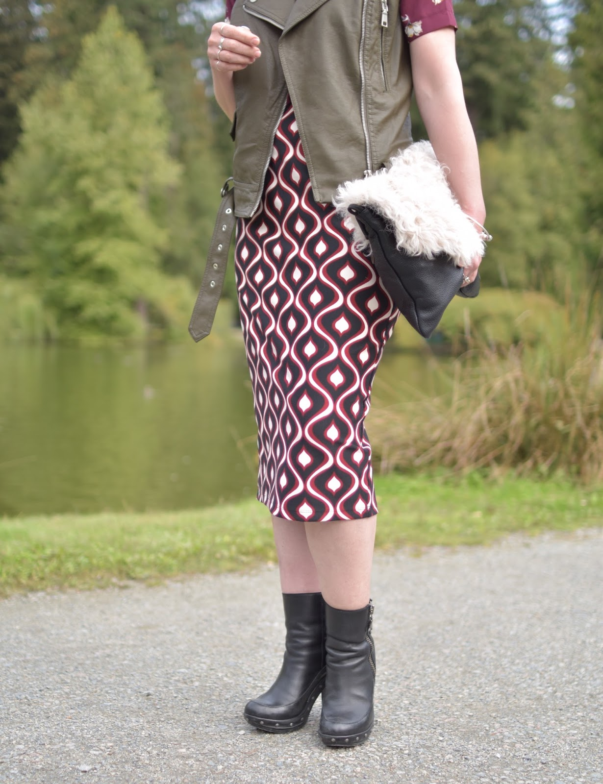 patterned pencil skirt, floral blouse, olive moto vest, platform booties