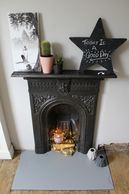 bedroom fireplace with painted concrete hearth