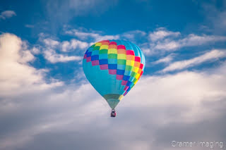 Cramer Imaging's fine art photograph of one colorful hot air balloon taking flight in Panguitch Utah with a blue morning sky