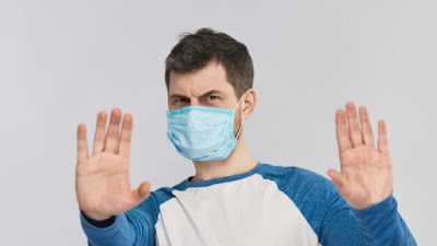 Panduan Baru CDC Menyarankan Melakukan Tiga Hal Ini Dengan Masker Anda Untuk Perlindungan Yang Lebih Baik Terhadap COVID-19