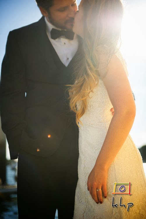 Lauren and Jason embrace each other while the setting California sun is shining upon them