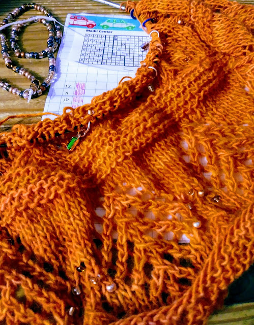 I'm knitting a beaded, estonian lace shawl with Malabrigo lace weight yarn.  I'm replacing the knups with beads.