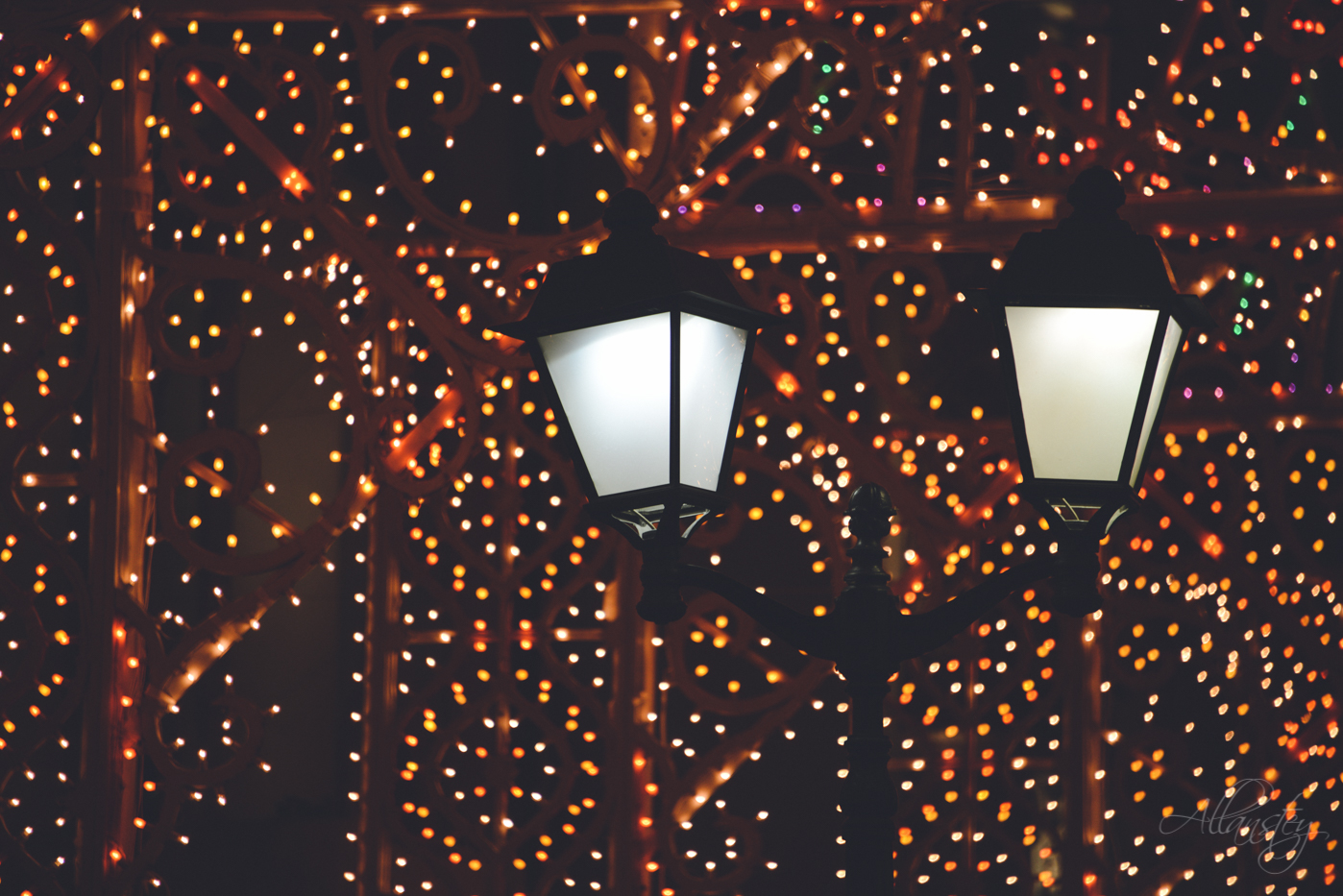 Lantern and Christmas lights on Nikolskaya Street in Moscow, Russia.