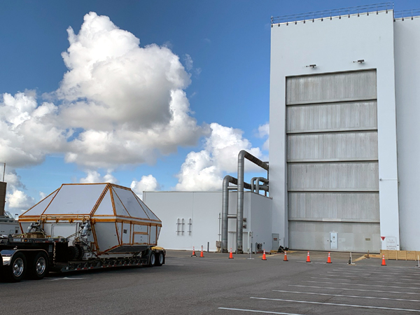 The payload canister carrying Orion's pressure vessel for NASA's Artemis 3 mission is transported to the Neil Armstrong Operations and Checkout Building at Kennedy Space Center's Industrial Area.