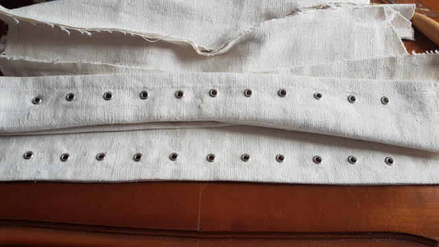 Edwardian corset with all of the eyelets punched into it on both sides