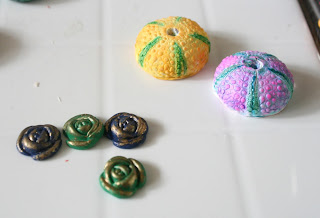 Polymer clay roses and urchins