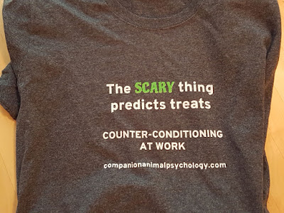 The scary thing predicts treats, message on a t-shirt for people with fearful dogs.