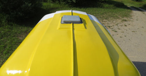 roof of a yellow and white fiberglass trailer