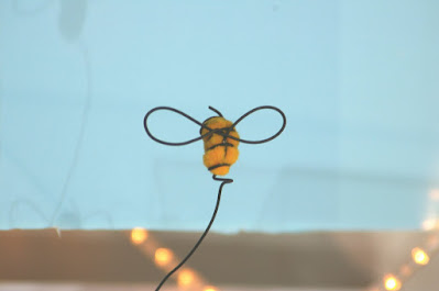 diy bee made from pom poms and wire