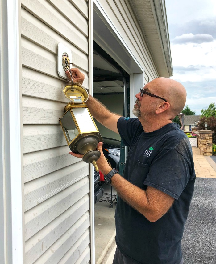 Hubby taking off outdoor light fixture