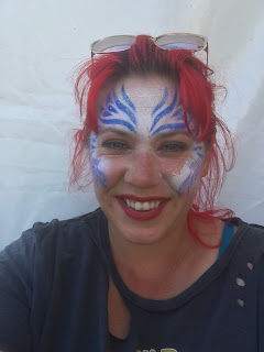 red head wearing face paint