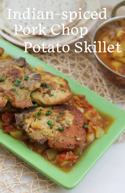 Food Lust People Lust: In this Indian-Spiced Pork Chop Potato Skillet you cook the chops till tender in a spicy tomato-onion sauce. Add potatoes and you have a full meal in one pan.