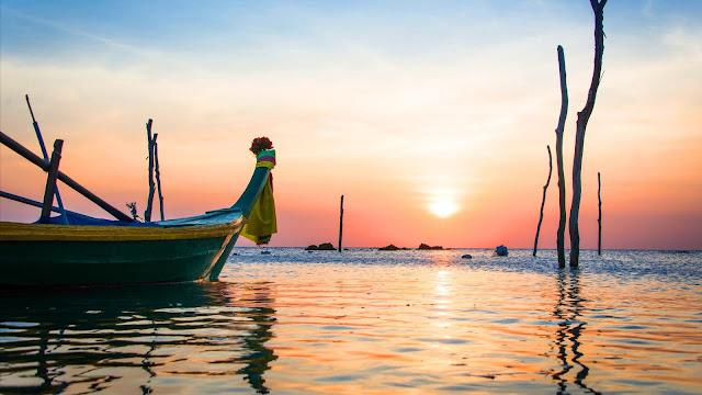 Canoe Sea Sunset desktop wallpaper