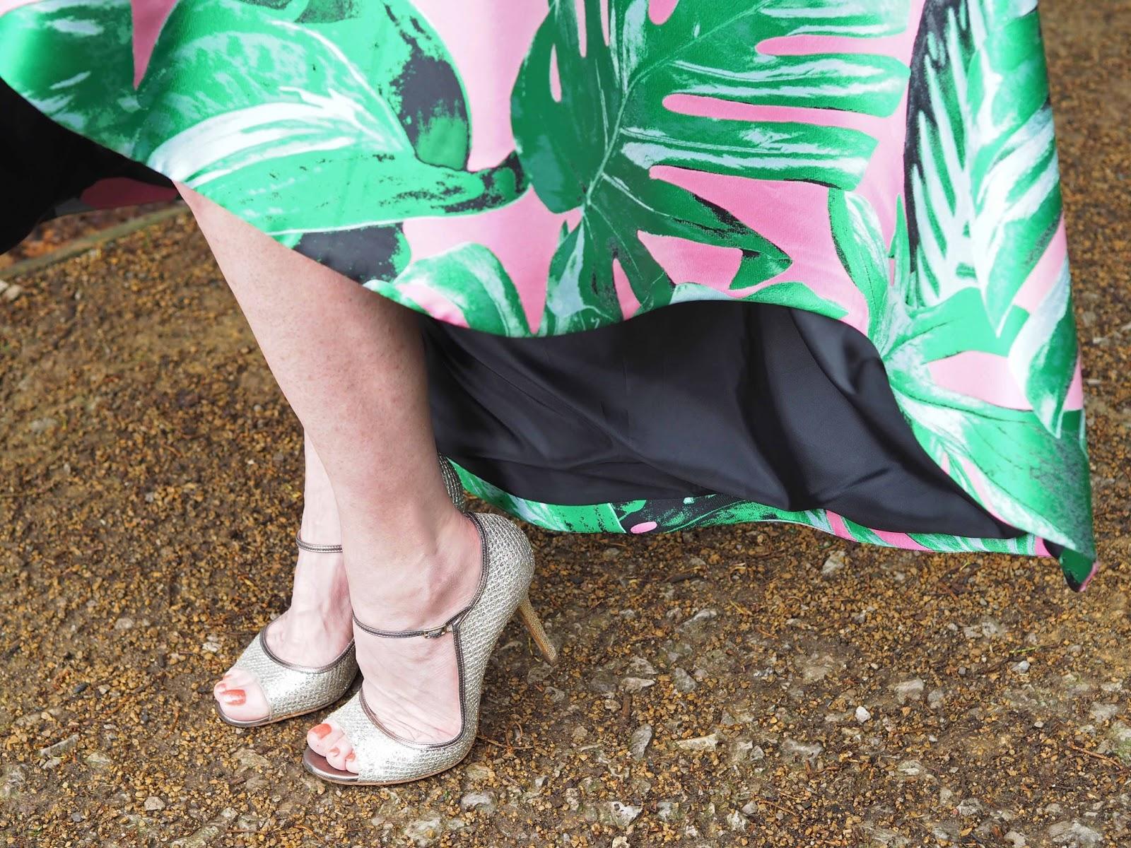 Asymmetric hem statement skirt, pink and black with large leaves, champagne glitter Jimmy Choo Tahiti sandals, occasionwear