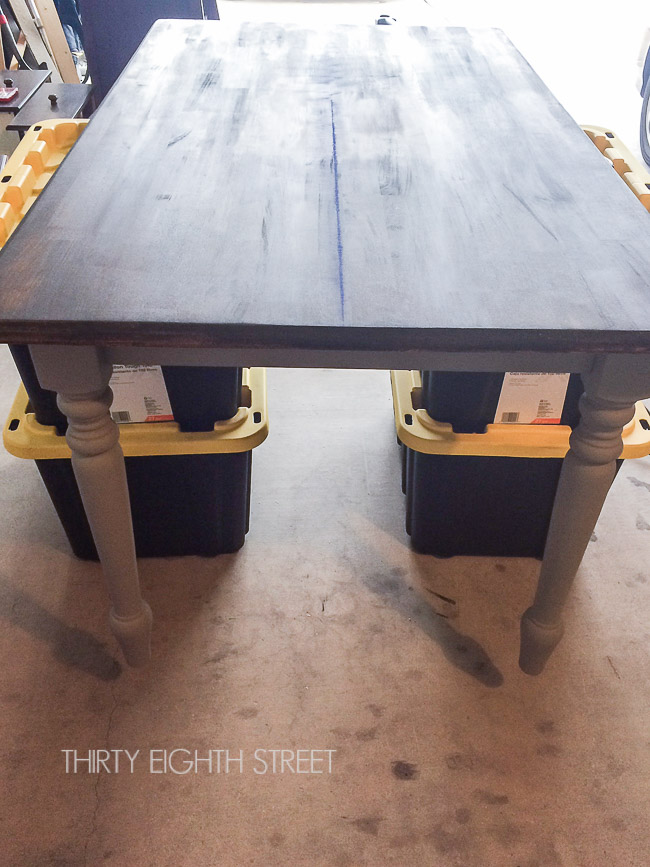 drawing a chalk line, cutting a table in half, turn a table into a desk, farmhouse desk from table